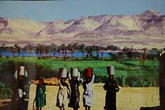 Nubian women buckets